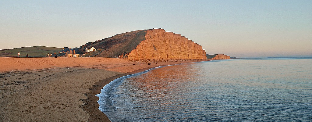 West Bay East Cliff At Dusk